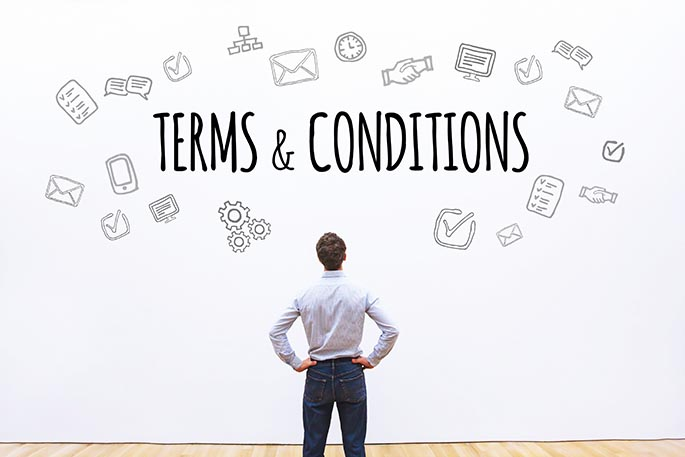 Picture of man looking at whiteboard with the phrase terms and conditions written on it to accompany a blog post about Uber terms of service changes